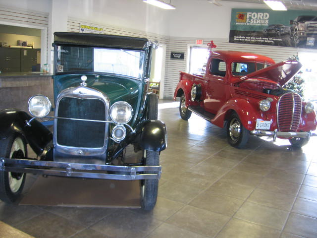 a 29 Model A and a 1939 V8 on display in our showroom!